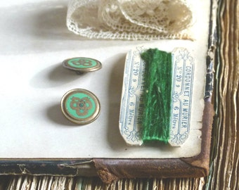 Beautiful and rare collection w/ pair green enamel bow buttons, antique emerald silk thread card, antique lace, prop styling
