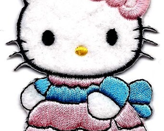 Hello Kitty wearing pink dress with blue ribbon sash Embroidered Iron On / Sew On Patch - Sanrio