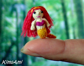 Miniature amigurumi mermaid with red hair. Comes with FREE display box.