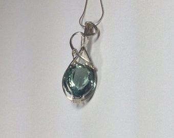 Blue quarts pendant wrapped in sterling silver
