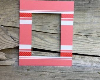 Hand painted 8x10 mat w/ 5x7 opening.   Pink mat with white and red stripes.