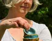 Hand built set of four wabi sabi bowls turquoise and wheat brown