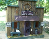 Primitive Lighted Country Store Folk Art  Stained w/ dark green accents ~ Comes w/ light and cord ~ Birdhouse ~  Very unique