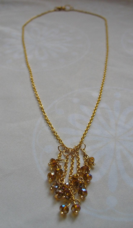 delicate gold chandelier necklace iridescent bronze
