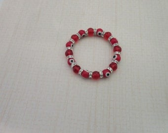 Red beaded evil eye bracelet with red glass beads.