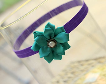Handmade purple and teal flower child baby stretchy headband.