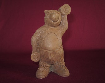 "Bear holding bar bells,5"" molded pecan resin figurine,unpainted"