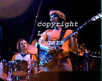 Concert photo of Grateful Dead, close up of Phil Lesh, taken 5/7/77 Boston Garden