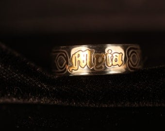 Sterling Silver Name ring with 24kt. Yellow Gold and Rose Gold Inlay work.