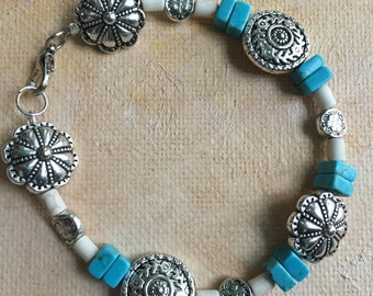 Turquoise and silver bracelet.