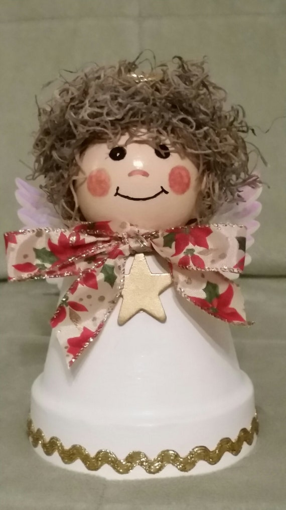 Items similar to terracotta clay pot christmas angel shelf