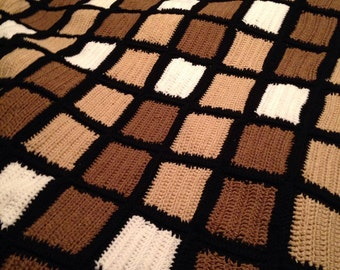 Crocheted comforter coverup for a queen size bed