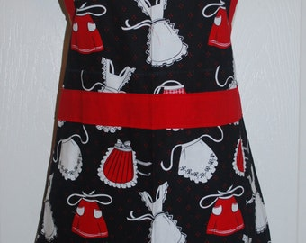 Adorable apron with apron print in red and white on a black background