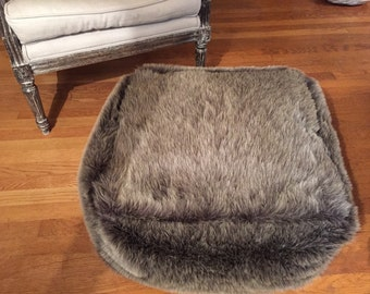 Made to order floor ottoman, in faux fur or other fabric of your choice.