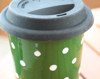 Ceramic travel mug hand decorated with polka dots (green and white)