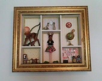 Reinterpretation of a House of dolls Mixed media sculpture Assembly shadowbox