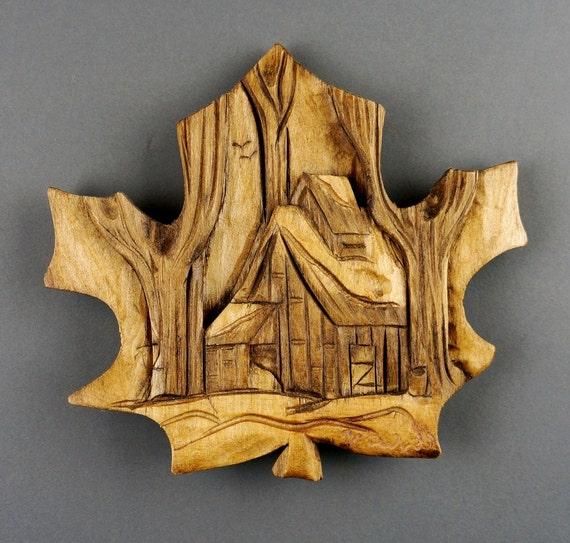 Sugar shack maple leaf carved on wood wall art by vladimir