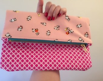 Folding over pink panda clutch bag