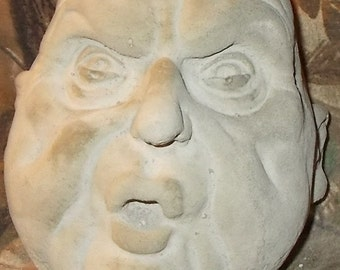 """concrete statue of creepy head """"Larry"""""""