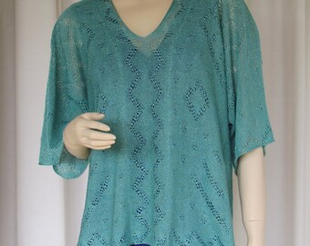 A Linen Top, hand-loomed in England. Open lace motifs with kimono sleeves