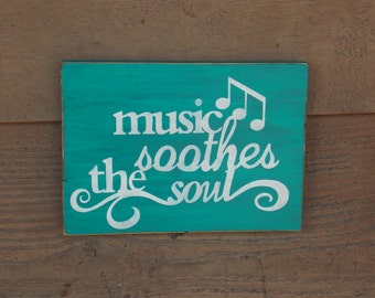 Music soothes the soul sign.