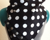 Fashionable, polka dot infinity scarf with black suede trim and antiqued silver snaps.
