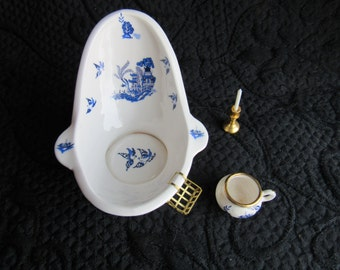miniature china bath tub with soap holder , commode and candle
