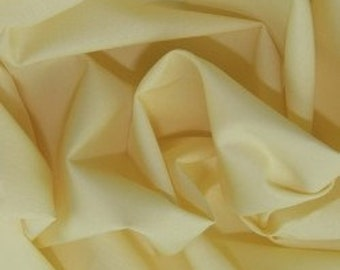 Pale yellow 100% cotton fabric.