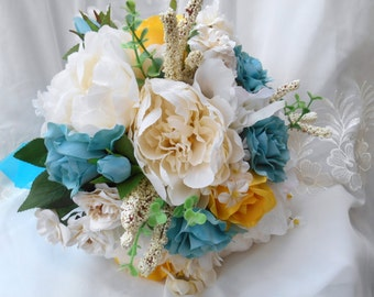 Bridal bouquet peonies ivory yellow and turquoise blue nosegay style bridal bouquet