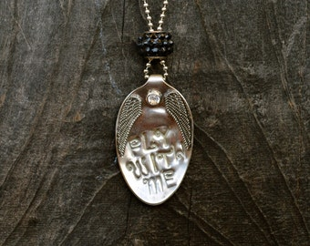 Fly with me spoon necklace.