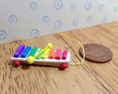 Hand made Dolls house Miniature replica vintage fisher price pull a tune xylophone 112 scale