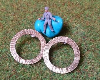 Circular earrings.