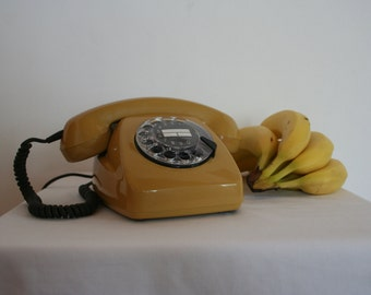 1970's rotary telephone. Mint condition! From Germany. Pastel mustard.