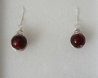 Herringbone wrapped red bead earring