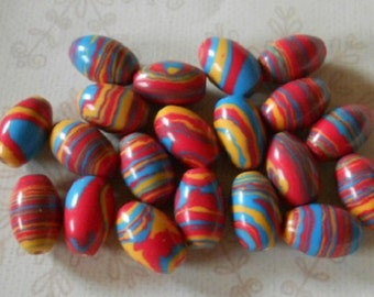A pack of 10 synthetic turquoise beads, rice