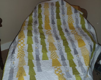 Contemporary designed quilt in yellows, whites, grays and greens.  Will work as a wedding gift, a gift for the home or baby quilt.