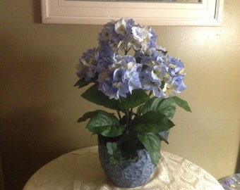 Faux Silk light blue hydrangea arrangement with dark green leaves in Blue Floral Ceramic pot.