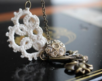 Tatted charm necklace.