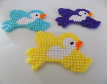Small colorful little birdies magnets.