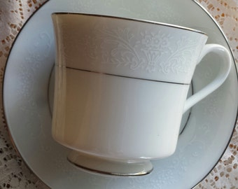 Tea cup and saucer 6 piece set by Wakefield made by International Silver Co.