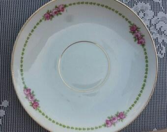 Antique Limoges pink roses and green tulip trim saucers. L. Bernardaud Co.