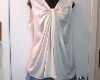 August Silk polyester size M.  Light cream top. So many possibilities-just imagine.