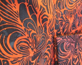 Batik, high quality cotton with navy background with orange swirls batik.