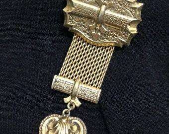 Gold vintage brooch