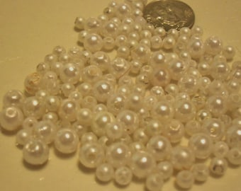 Assorted plastic white pearl beads