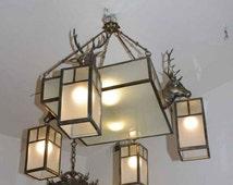 Figural chandelier in the shape of deer heads