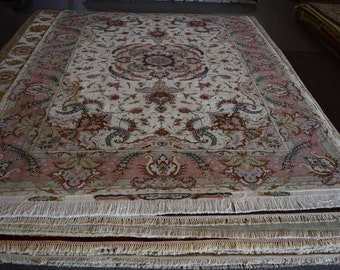 7 x 10 Signed Persian Tabriz hand knotted rug