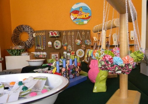 Tefi's setup highlights the vibrant colors of her products.