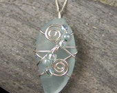 Pale aqua upcycled sterling silver wire wrapped sea glass pendant for a beach lover