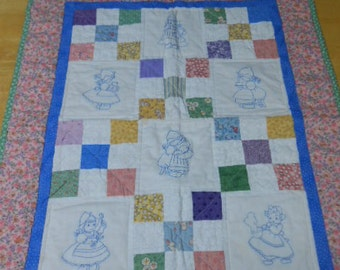 Sweet little 9 patch embroidered baby quilt
